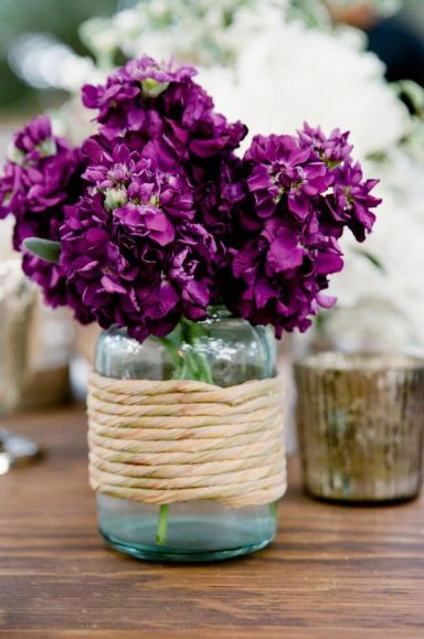 Radiant Orchid flowers in a jar